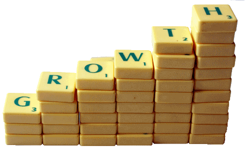 Picture of scrabble pieces climbing up to right spelling growth