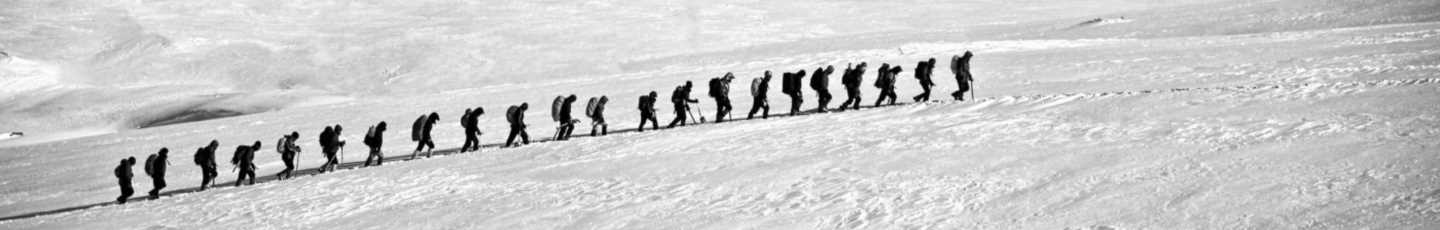 Picture of team climbing snow mountain